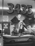 Men Standing in the Window of a Car Dealership Premium Photographic Print by Francis Miller