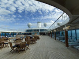 Tables and Chairs on the Pool Deck of a Cruise Ship Fotoprint van Todd Gipstein