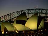 A View at Night of the Famed Sydney Opera House and the Citys Harbour Bridge Photographic Print by Medford Taylor