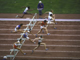 Women Athletes Perform in a Hurdle Event at the Summer Olympics Premium Photographic Print by George Silk