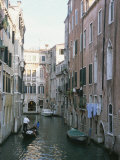 A Gondolier on a Residential Canal in Venice Photographic Print by Taylor S. Kennedy