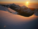 Sunset Glow over a Snowy Mountain Face Fotografie-Druck von Annie Griffiths Belt