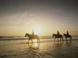 Horseback Riders Silhouetted on a Beach at Twilight, Costa Rica Photographic Print by Michael Melford