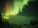 The Aurora Borealis Shimmers in the Night Sky Fotoprint van Norbert Rosing