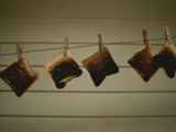 Burnt Toast Hanging on Clothesline Photographic Print by Todd Gipstein