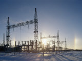 A Twilight View of Sunlight Passing Through an Electric Substation Fotografisk tryk af Norbert Rosing