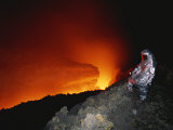 Scientist in Full Helmet and Thermal Suit Collects Lava Samples Photographic Print by Peter Carsten