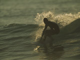 A Surfer Rides a Gentle Swell Photographic Print by Tim Laman
