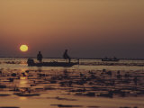 Fishermen Take in the First Rays of the Rising Sun on Lake Okeechobee Photographic Print by Nicole Duplaix
