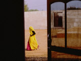 A Person Walking Past an Open Doorway Photographic Print by Michael S. Lewis