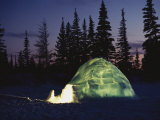 A Warm Glow Eminates from an Igloo Photographic Print by Norbert Rosing