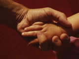 A Father Holds His Daugters Small Hand Photographic Print by Roy Gumpel