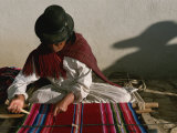 A Bolivian Woman Weaves Brightly Colored Fabric on a Loom Photographic Print by Kenneth Garrett