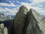 A Climber Standing at the Top of a Mountain in the Dolomites, Italy Fotodruck von Ed George