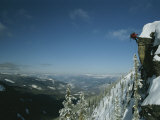 Rappeling with Snowboard, Red Mountain, British Columbia Photographic Print by Mark Cosslett