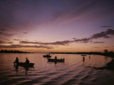Silhouetted Fishermen on the Kissimmee River at Sunset Photographic Print by Medford Taylor