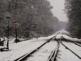 Railroad Tracks in Snow at the Courtland City Limit Photographic Print by Medford Taylor