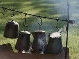 Four Metal Coffee Pots Steaming over an Outdoor Grill Photographic Print by Michael S. Lewis