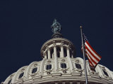 An American Flag and the Statue of Freedom Atop the Capitol Dome Photographic Print by Medford Taylor