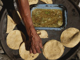 A Vendor Displays a Sample of Local Mexican Cooking with Tortillas Photographic Print by Kenneth Garrett