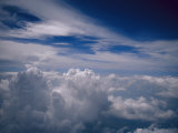 A Cloud-Filled Sky Above Miami Photographic Print by Raul Touzon