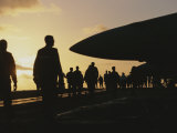 Silhouetted Military Personnel on an Aircraft Carrier at Twilight Photographic Print by Medford Taylor