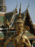 A Golden Buddha Statue Stands Outside the Grand Palace in Bangkok Photographic Print by Jodi Cobb
