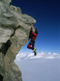 Mountain Climber Dangles from Rock on Pyramid Peak Photographic Print by Gordon Wiltsie