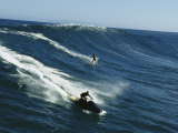 A Surfer and Jet-Skier off the North Shore of Maui Island Photographic Print by Patrick McFeeley