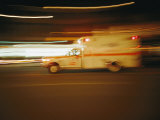 An Ambulance Rushes Past at Night Photographic Print by Stephen St. John