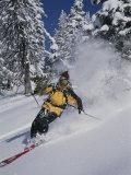 A Skier Cuts Through Some Untouched Powder in Montana Fotografisk trykk av Bobby Model