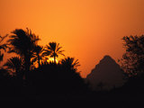 The Step Pyramid of Djoser Silhouetted by the Setting Sun Photographic Print by Kenneth Garrett