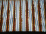 Lines of Rust Make a Bold Pattern Across an Old Corrugated Barn Roof Photographic Print by Stephen St. John
