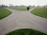 A Couple Stand Near the Intersection of Paved Paths in Hyde Park Photographic Print by Paul Chesley