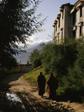 Monks Walk along a Path outside a Monastery Photographic Print by  xPacifica