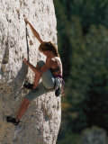 A Female Climber Searches for a Hold Photographic Print by Bobby Model