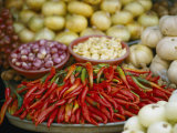 Close View of Chili Peppers and Other Vegetables at a Food Market Photographic Print by Steve Raymer