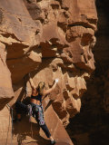 A Woman Climbs Sandstone Cracks in Utah Photographic Print by Bobby Model