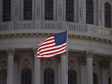 A Backlit American Flag Glows against the Dome of the Capitol Building Photographic Print by Stephen St. John