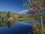A Lake Surrounded by Trees Displaying the Colors of Autumn Photographic Print by Richard Nowitz