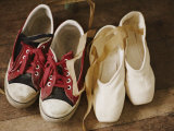 A Pair of Tennis Shoes with Red Laces Sits Next to a Pair of Ballet Slippers Photographie par Jodi Cobb