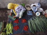 A Woman Sells Vegetables at an Open-Air Market in Malaysia Photographie par Steve Raymer