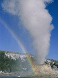A Rainbow Forms During an Eruption of Castle Geyser Photographic Print by Norbert Rosing