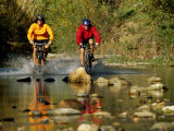 Mountain Bikers Enter a Rocky Stream Photographic Print by Barry Tessman