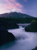 Twilight View of Rio Petrohue Winding Through Rocks with Osorno Volcano in the Background Photographic Print by George F. Mobley