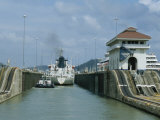 Tugboat Guiding Ship Through a Lock, Panama Canal Photographic Print by James P. Blair