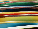 A Close-up of a Stack of Boats Showing Bright Colored Stripes Photographic Print by Todd Gipstein