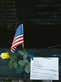 Rose, Flag, and Note of Remembrance Left by a Family at Memorial Wall Photographic Print by Klaus Nigge