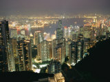 The Hong Kong Skyline is Lit up at Night with Thousands of Lights Photographic Print by Paul Chesley