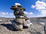 The Stacked Stones of a Cairn Marker in the Arizona Landscape Photographic Print by Paul Nicklen